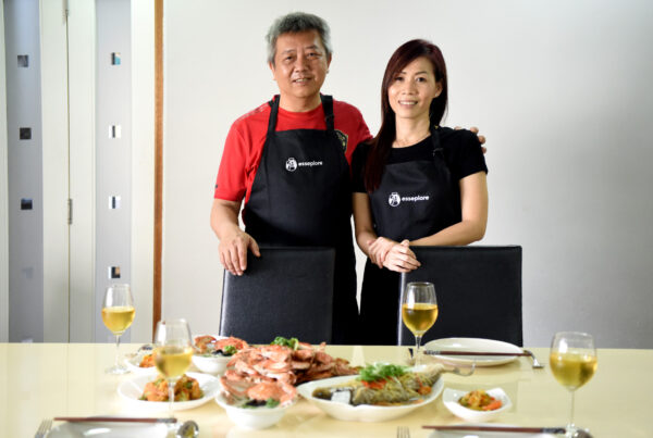 Esseplore's Angler Home Chefs Andrew and Sandy standing behind a table set with a seafood feast