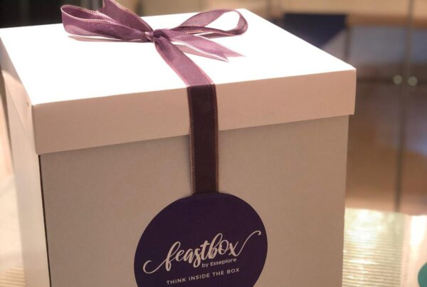 Esseplore's environmentally friendly white Feastbox tied with its signature violet ribbon