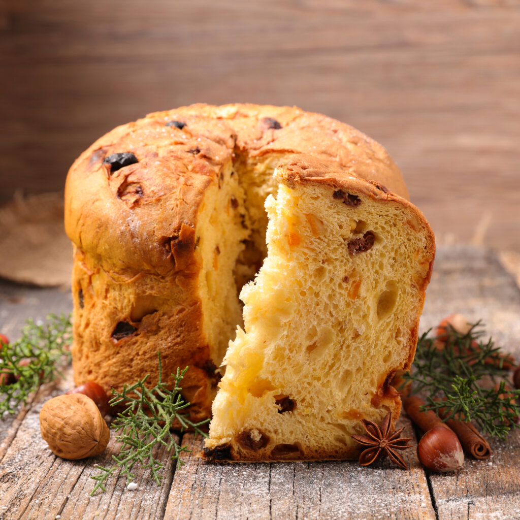 Panettone or Italian Christmas Bread is a sponge-like bread enriched with a mix of dried raisins, citron, candied orange and chopped almonds.