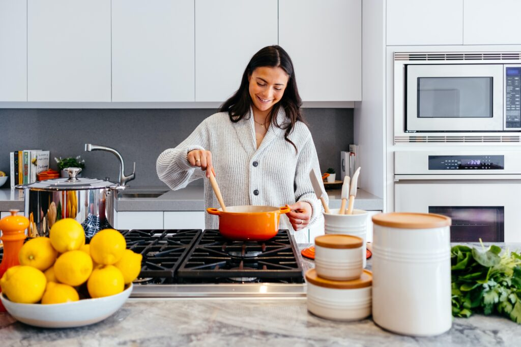 be a home chef at Esseplore - woman cooking in her kitchen